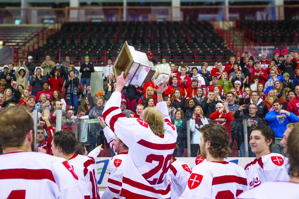 The SJU hockey team captured the MIAC tournament trophy in a 3-2 victory over Gustavus. Johnnie hockey fans celebrated the win.